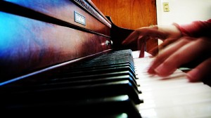 Beginning piano requires less finesse than beginning guitar.  Fingers simply press keys.