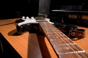 You can usually see if a neck is warped by looking straight down the length of the fretboard.